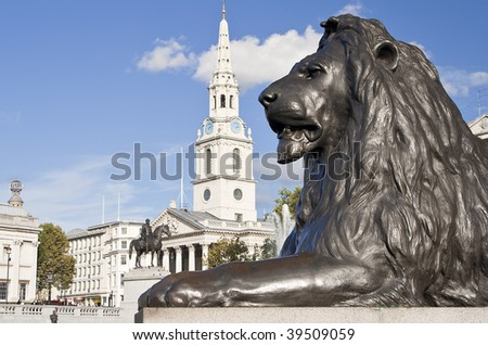 Statue of a lion in the Nelson column in Trafalgar Square in London - stock photo