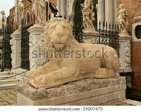 statue of a lion outside the Arsenale building in venice