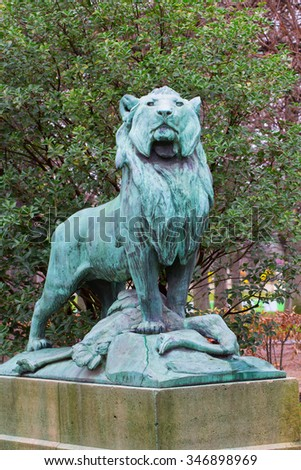 Statue of a lion who has hunt down an ostrich in the park de Luxembourg in Paris, France - stock photo