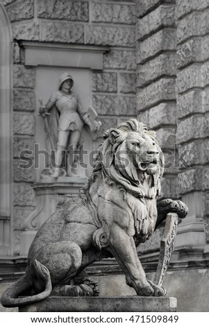 Statue of a lion with a shield at the entrance of Hofburg Palace, Vienna, Austria