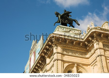 Statue of a man on top of horse on a roof of building in Vienna, Austria