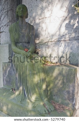 Statue of a mourning woman in an old German cemetery