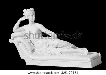 statue of a naked woman on a black background - stock photo