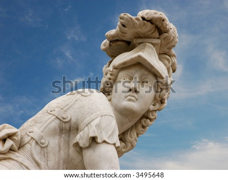 Statue of a roman warrior against blue sky - stock photo