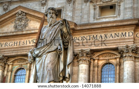 Statue of a saint in front of St-Peters Basilica. Pseudo HDR image created from a single HDR file. - stock photo