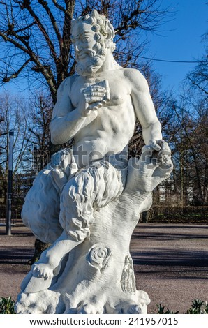 statue of a satyr - stock photo