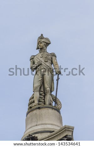 Statue of Admiral Nelson on top of Nelson's Column in Trafalgar Square, Westminster, Central London. Monument built to commemorate Admiral Horatio Nelson, who died at Battle of Trafalgar in 1805. - stock photo