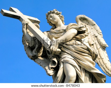 Statue of an angel holding a cross outside of Castel Sant'Angelo in Rome, Italy.