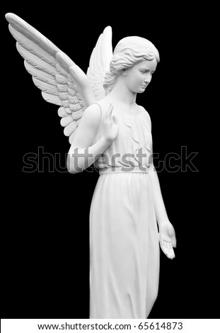 Statue of an Angel Isolated on Black - stock photo