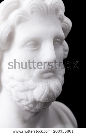 Statue of ancient Greek god of medicine and healing Asclepius, isolated on black background - stock photo