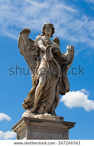 Statue of angel on ponte San Angelo with blue sky background, Rome - stock photo