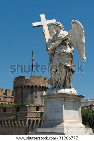 Statue of angel with Castel Sant Angelo, Rome - stock photo