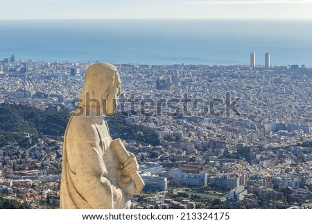 Statue of apostle observing city of Barcelona from top of Expiatory Church of the Sacred Heart of Jesus (Temple Expiatori del Sagrat Cor) on summit of Mount Tibidabo in Barcelona, Catalonia, Spain. - stock photo