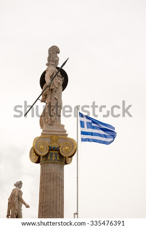 Statue of Athena and the Greek flag on the facade of the Academy of Athens. Copy space - stock photo