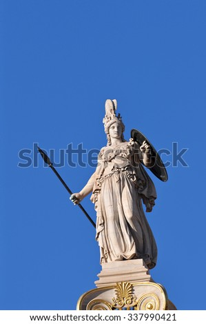 Statue of Athena on top of a pillar in front Academy of Athens, Greece  - stock photo