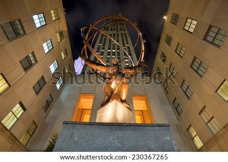 Statue of Atlas holding the Heavens, on Fifth Avenue at the Rockfeller Center on November 07, 2014 in Manhattan, New York - stock photo