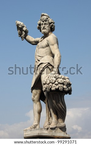 Statue of Bacchus in Holy Trinity Bridge of Florence, Italy - stock photo