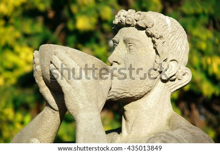 Statue of Bacchus the Roman god of agriculture and the alcohol wine, similar to the Greek Dionysus - stock photo