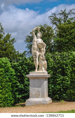 statue of Bacchus with grape in the Gardens of Versailles, France - stock photo