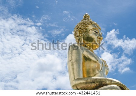 Statue of Buddha with blue sky  background in Thailand. - stock photo