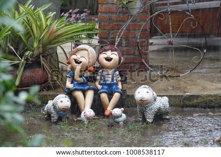 Statue Child Sheep Sit Garden Rain Stock Photo (Royalty Free) (Royalty  Free) 1008538117   Shutterstock