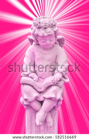 Statue of Cupid on pink white background - stock photo