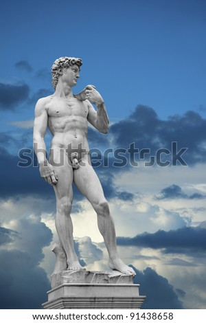 Statue of David on blue sky with white clouds. Copy of original in Florence, Italy - stock photo