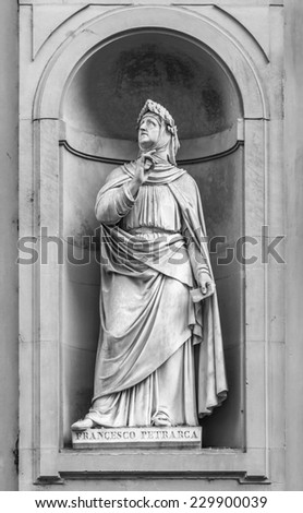 Statue of Francesco Petrarca in the niches of the Uffizi Gallery colonnade, Florence. - stock photo