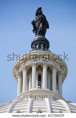 Statue of Freedom over Capitol Hill Building in Washington DC