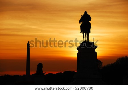 Statue of General Grant silhouette of US grant memorial and Washington Monument at sunset, Washington DC. - stock photo