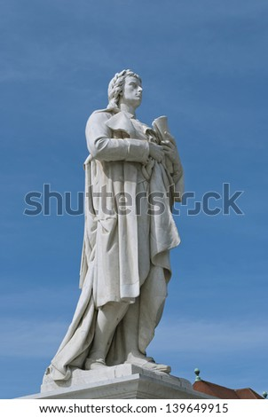 Statue of Germany's poet Schiller in front of the Konzerthaus on blue sky background, Berlin