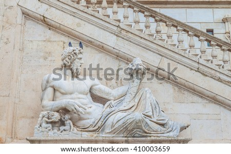 Statue of god(Tiber) with cornucopia at square Piazza del Campidoglio.Part of the sculpture composition of the Fountain of Goddess Rome.Work by Matteo di Castello.Capitol hill.Rome.Italy.Europe - stock photo