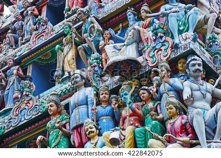 Statue of hindu gods on the shrine rooftop - stock photo