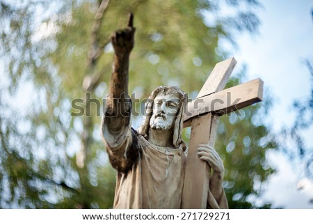 Statue of Jesus Christ at Rasu cemetery in Vilnius, Lithuania. Shot taken with a soft focus lens, shallow depth of field. - stock photo
