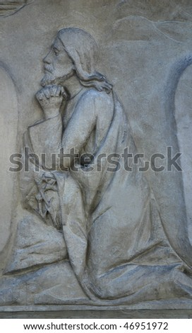 statue of jesus christ in old cemetery - stock photo