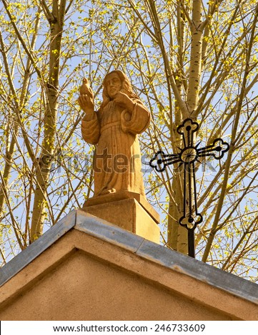 Statue of Jesus Christ on the roof of the temple - stock photo