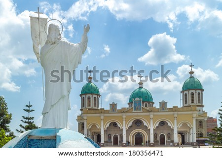 Statue of Jesus Christ overlooking Bole Medhane Alem Church in Addis Ababa, Ethiopia - stock photo