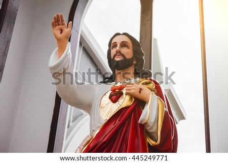 Statue of Jesus Christ, Sacred Heart, Christianity symbol, Lens flare effect  - stock photo