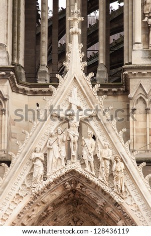 statue of jesus on the front of  Cathedral of Notre-Dame, Reims, France - stock photo