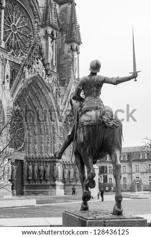 Statue of Joan of Arc on the horse in front of  the Cathedral of Notre-Dame, Reims, France - stock photo