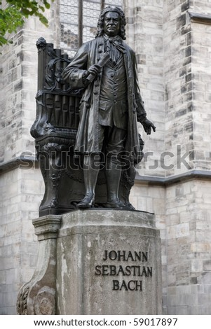 statue of JS Bach in front of St. Thomas Church in Leipzig, Germany - stock photo