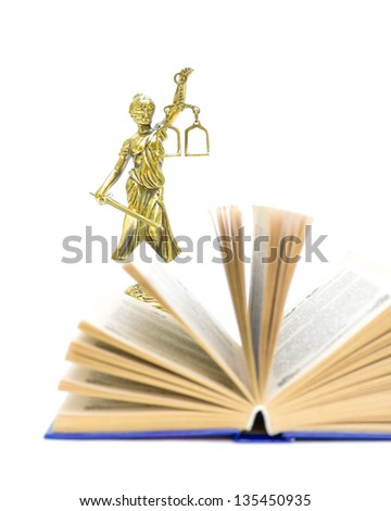 statue of justice and book on a white background. the book is not in focus. vertical photo. - stock photo