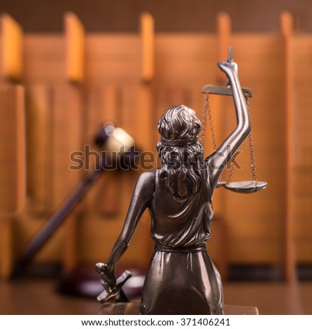 Statue of justice and Wooden gavel, law concept - stock photo
