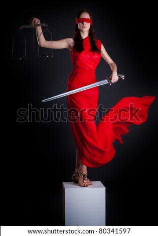 Statue of justice. Blind Woman with scale and sword. - stock photo