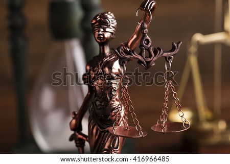 statue of justice, hourglass, scales of justice - stock photo