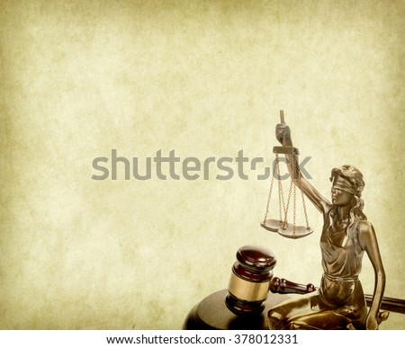 Statue of justice on old paper background with gavel, law concept - stock photo