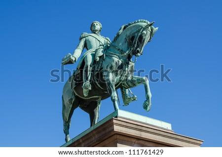 Statue of king Carl Johan - stock photo