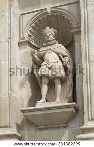 Statue of King Carlos I of Spain on the Baroque facade of The Basilica of Our Lady of Solitude located in Oaxaca de Juarez, Mexico. - stock photo