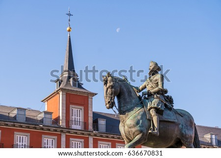 Statue Of King Philip in Plaza Mayor in Madrid Spain, Tower and Moon in the Sky