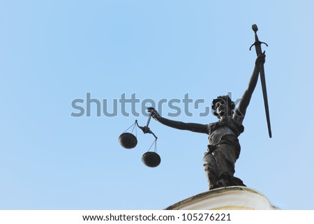 Statue of Lady Justice seen on the old town hall of Ingolstadt - stock photo